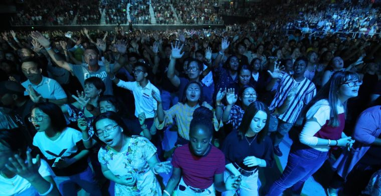 Young people worship God at the Graham tour event in Melbourne.