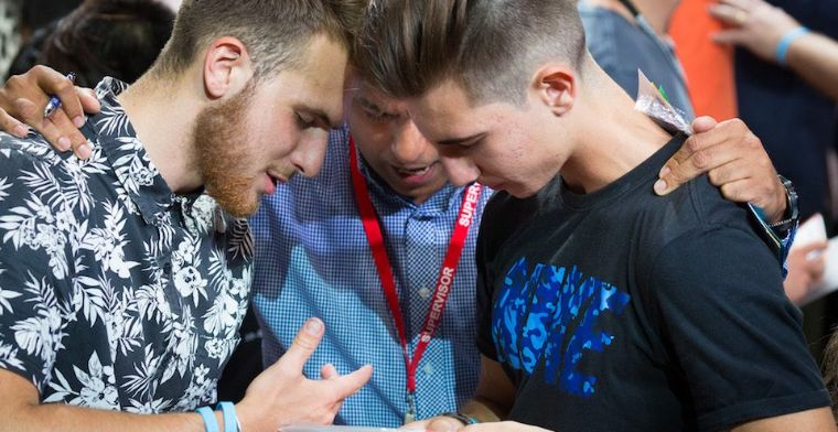 Young men respond to the invitation to prayer, at Adelaide Arena.
