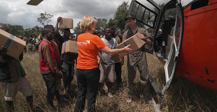 World Vision CEO Claire Rogers helps deliver aid to an isolated community of Beira, Mozambique.