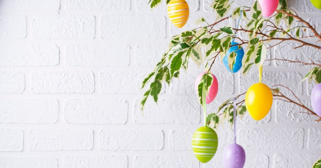 photo of easter eggs hanging on a tree