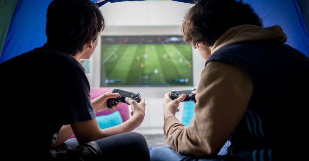 photo of two boys playing an x box