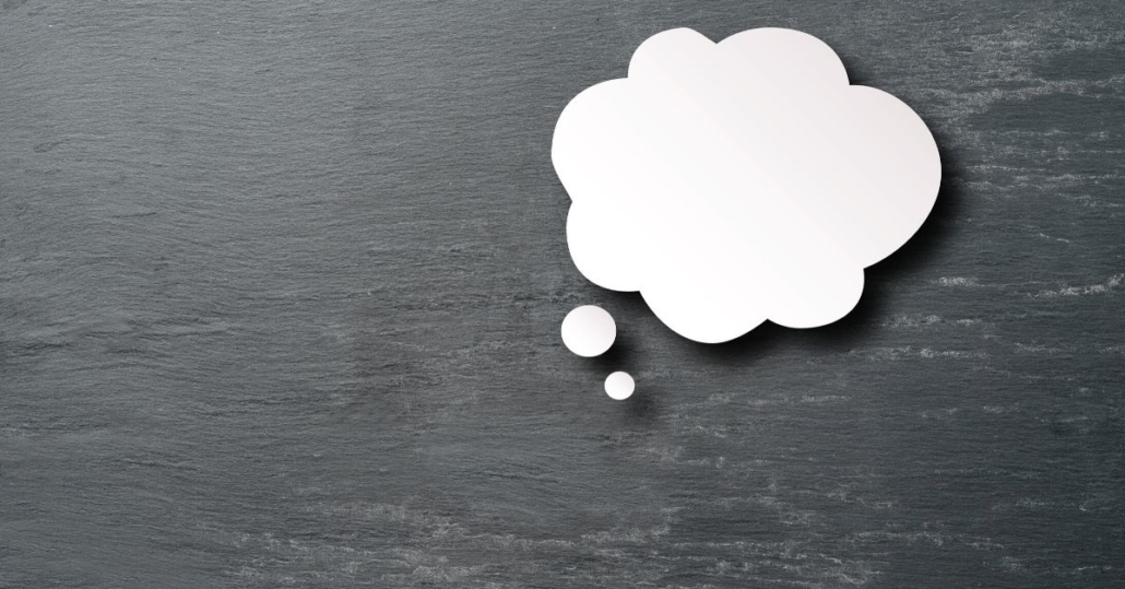 photo of a thought bubble on a grey background